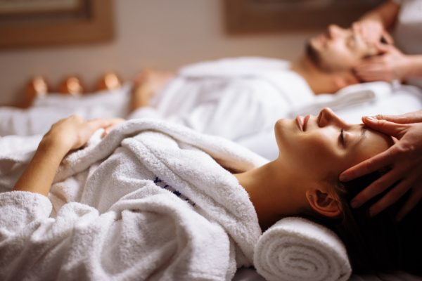 man and woman enjoying relaxation therapy