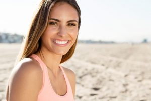 Young woman smiling on the beach
